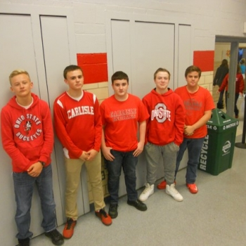 8th graders wearing red to support our Veterans
