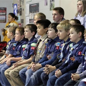 Cub Scouts present the colors and lead the audience in the pledge of allegiance