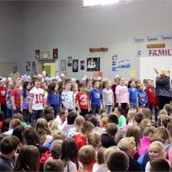 Class of 2026, directed by Mrs. Wiggins, share a song