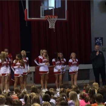 Varsity cheerleaders perform for Gigsby students
