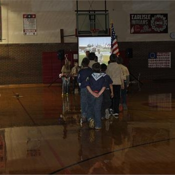 Cub Scouts present the American flag