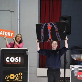 Mrs. Seaborn assists in an activity for COSI on Wheels