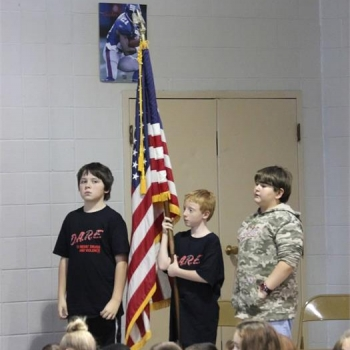 Cub Scouts present the colors and lead the crowd in the Pledge of Allegiance