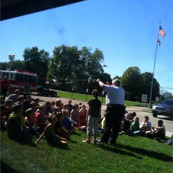 Carlisle fire department with Grigsby students