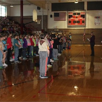 Fifth grade students share a song with local veterans