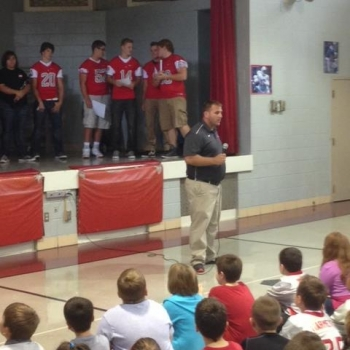 High school coaches and athletes talk with Grigsby students