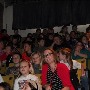 Students and staff watching the Veteran's Day celebration