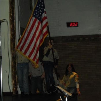 Boy Scouts present the flag
