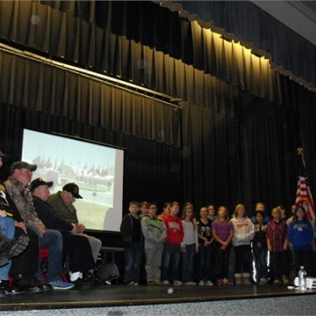 Fifth grade students share a song to celebrate Veteran's Day