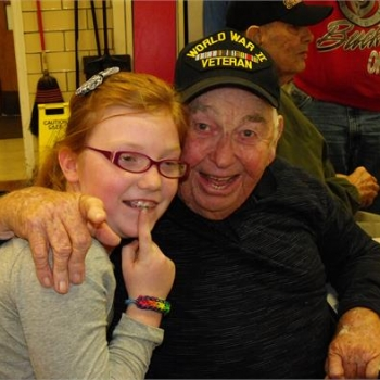 A child and a veteran enjoying one another's company