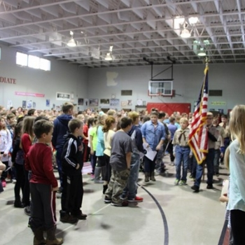 Local Boy Scouts present the colors and lead the audience in the Pledge of Allegiance